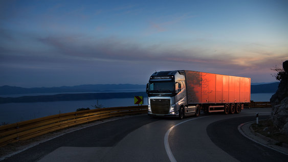 A silver Volvo FH 540 truck in sunset