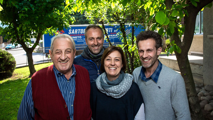 The Sartori Trasporti founder, Giorgio (left), with his daughter Cristiana, son Enrico (right) and Cristiana's husband Federico.